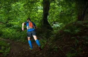 man trail running to show oakville physio clinic and sports physio