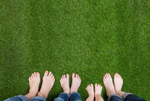 Family feet on the grass showing oakville Physio and foot clinic