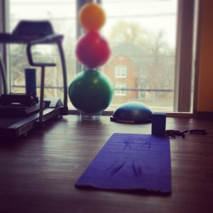 Yoga mat and exercise equipment looking out at Dundas and Bronte from our oakville Physio, massage and foot clinic