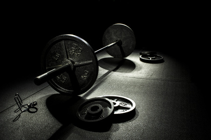 barbell and weights representing strength training in physio blog about different types of exercise