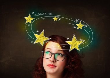 Girl with stars around head showing physio treatment in oakville for dizziness
