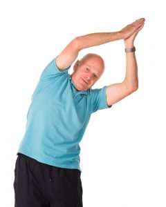 older man doing yoga at Palermo Physio in oakville