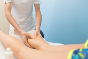 Calf massage for treatment of heel pain and sever's disease at oakville Physio, chiropody, and massage clinic