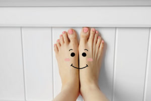 Happy face feet showing best oakville foot clinic, chiropodist, orthotics