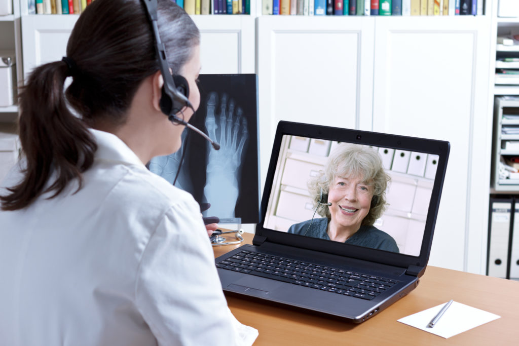 shows woman receiving Telehealth / tele rehabilitation in Milton, Oakville, Burlington Ontario for pain.