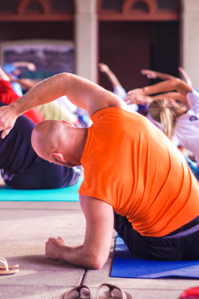 image of a yoga class in blog post at palermo physio about adding exercise to our routine