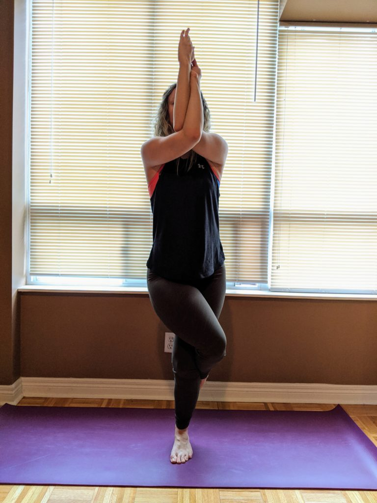 Mississauga physio showing an eagle yoga pose, typically practised in hot yoga, and always part of bikram yoga, in an educational blog