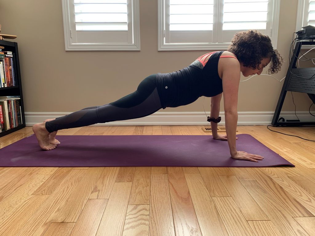 Bronte Physiotherapist showing a high plank and wrist pain during yoga
