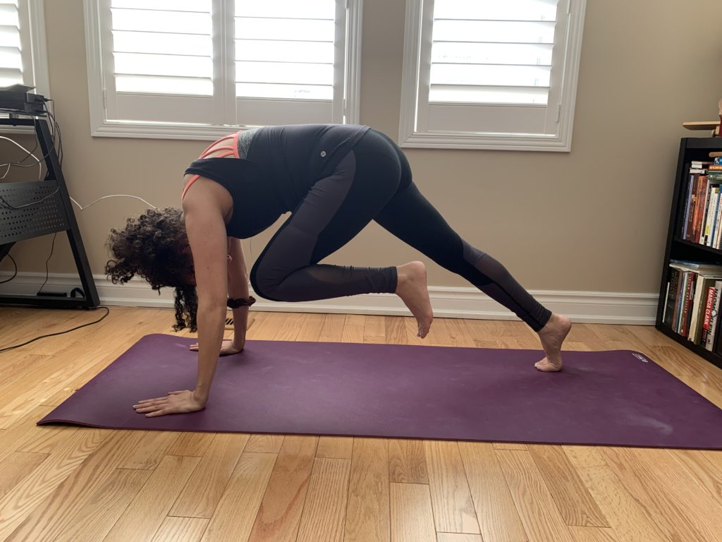 Burlington physio showing a knee-to-elbow plank yoga pose for core strengthening