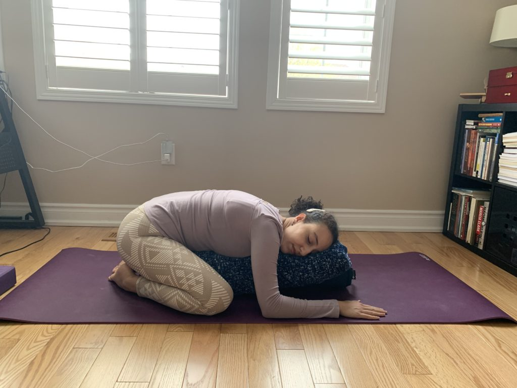 burlington physio showing a supported child's pose in an educational blog about restorative yoga