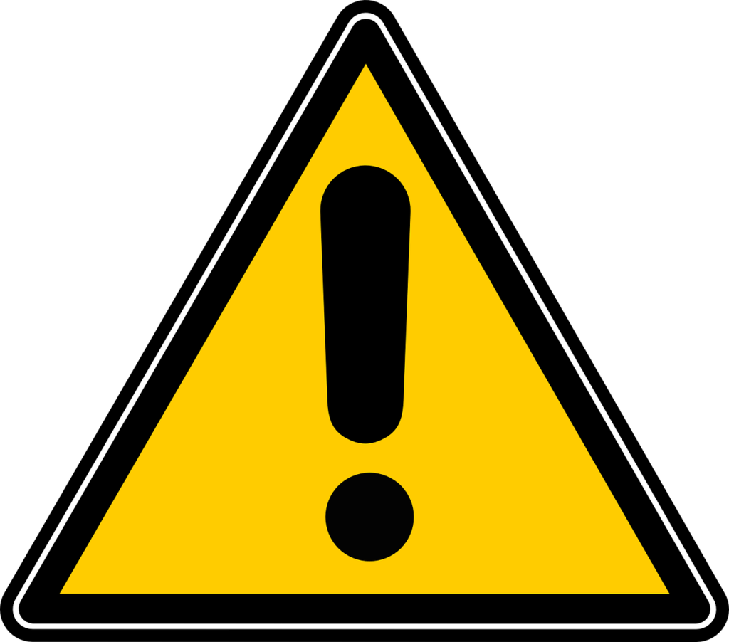 Caution sign illustrating the need to weigh pros and cons to medical imaging in a blog by Oakville physio discussing the pitfalls of imaging and the effects on the patient.