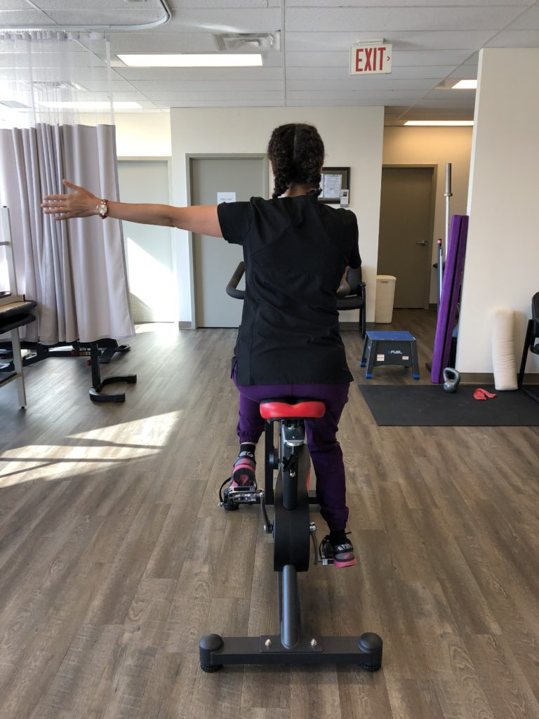 Oakville physio demonstrating left hand turn signal for cyclists in bicycle safety and helmet blog